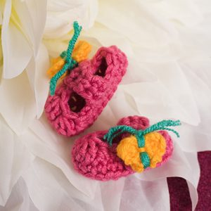 066f7c8d2c50 Baby will be ready for spring in these adorable butterfly booties featuring  a Mary Jane style and butterfly accents. Made from chunky yarn